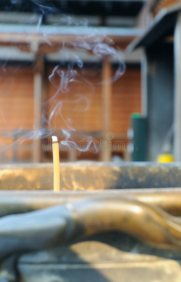 Incense stick with a smoke; japanese temple. A single stick of incense wafting perfume heavenward atYougen-in temple in Kyoto, Japan stock photography