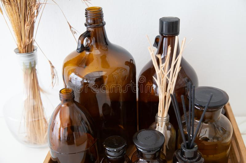 Set of incense sticks and brown fragrant bottle. royalty free stock photography