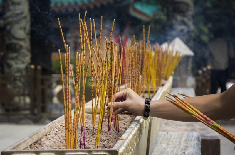 Incense sticks burning at a Taoist temple of Wong Tai Sin, Hong Kong. Yellow incense sticks burning at a Taoist temple of Wong Tai Sin, Hong Kong royalty free stock photos