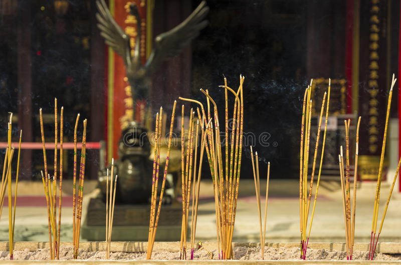 Incense sticks burning at a Taoist temple of Wong Tai Sin, Hong Kong. Yellow incense sticks burning at a Taoist temple of Wong Tai Sin, Hong Kong royalty free stock photography
