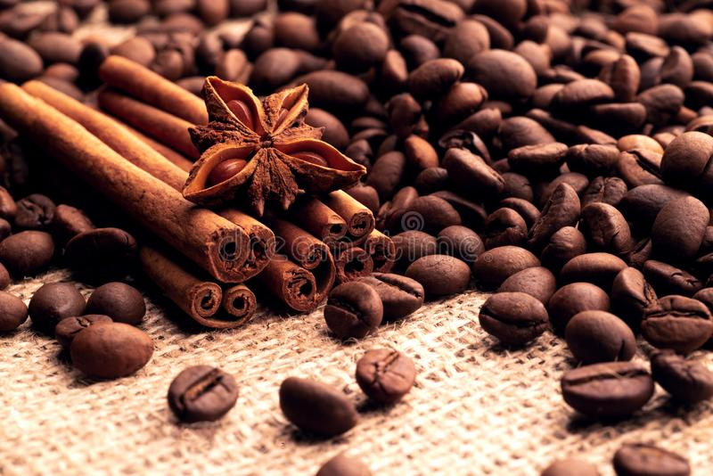 Incense sticks of cinnamon asterisk star anise anise and grains of roasted coffee.  royalty free stock photos