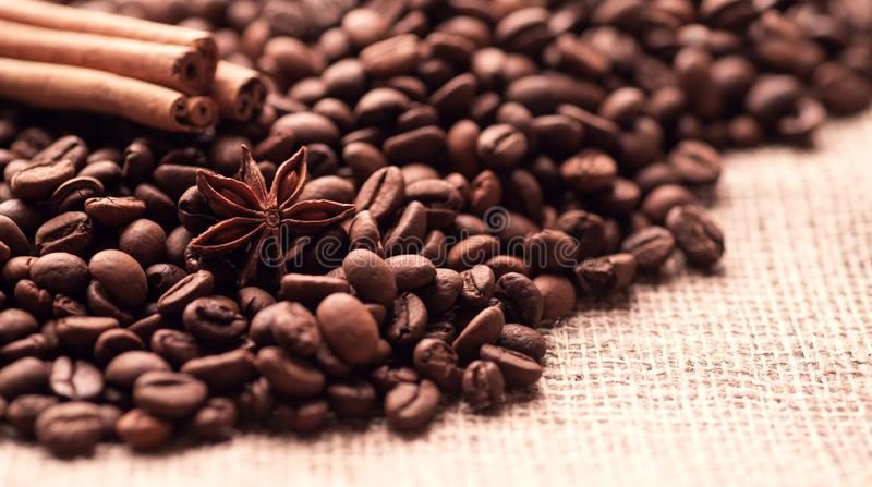 Incense sticks of cinnamon asterisk star anise anise and grains of roasted coffee.  stock photos