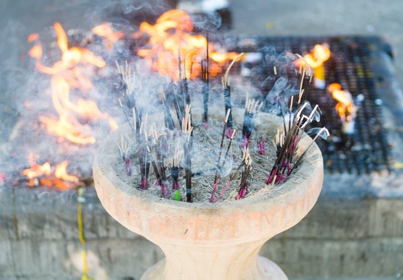 https://www.dreamstime.com/stock-images-incense-sticks-pot-burning-fire-background-image34024614
