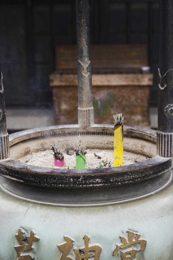 Incense sticks in pot near temple stock photography