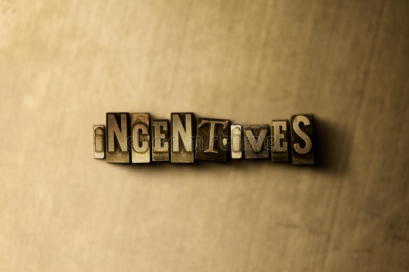 INCENTIVES - close-up of grungy vintage typeset word on metal backdrop stock illustration