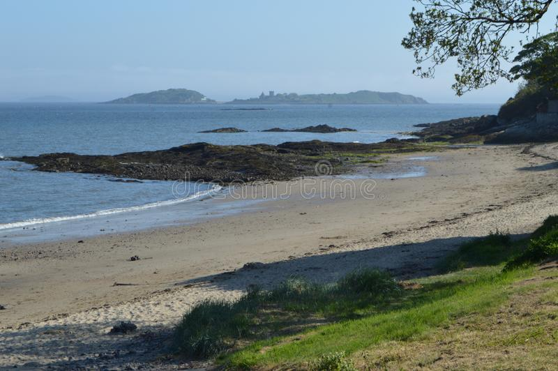 Inchcolm Island with Monastery, from Aberdour Harbour, Fife, Scotland royalty free stock images