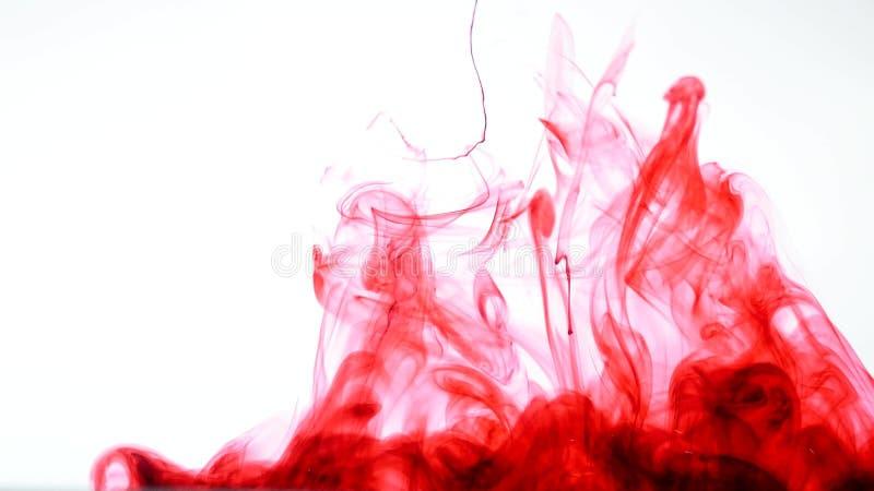Inchiostro rosso in acqua Estratto immagine stock libera da diritti