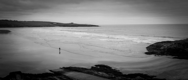 Inchydoney Beach Kinsale Cork Ireland black and white man waves. Amazing view royalty free stock photography