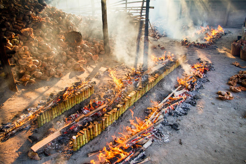 Incineration plant burns rice roasted in bamboo. sticky rice soaked in coconut milk.'Khao Lam' is Thai dessert , coconut milk wit. Incineration plant burns rice royalty free stock photo