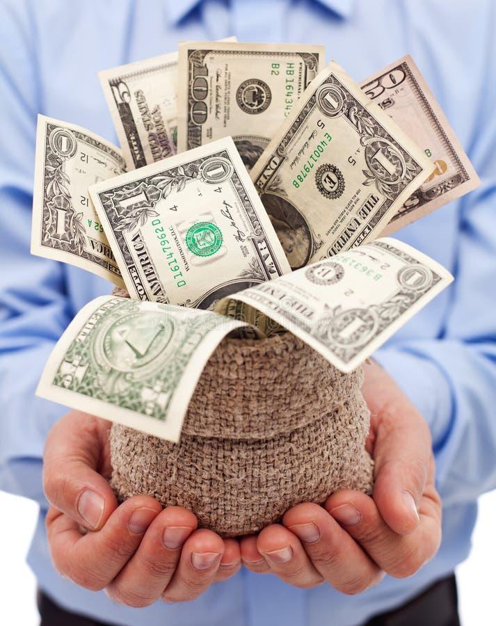 Incitation pour l'homme d'affaires - mettez en sac complètement des billets de banque du dollar photographie stock libre de droits
