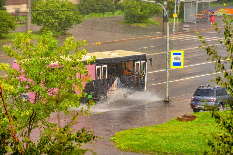 Inclement weather in the city in summer. Pouring rain in the city royalty free stock photo
