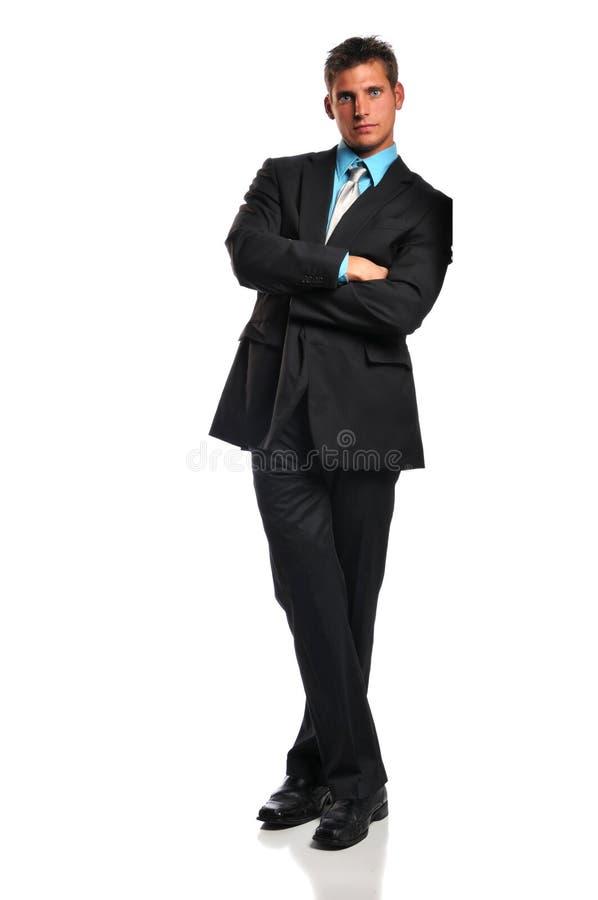 Inclinação do homem de negócios foto de stock