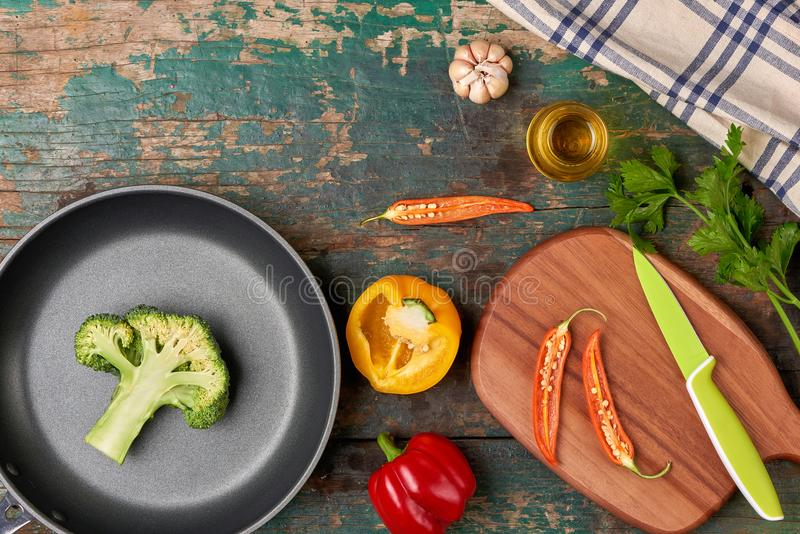 Include fresh organic vegetables and frypan on wooden floor stock photos