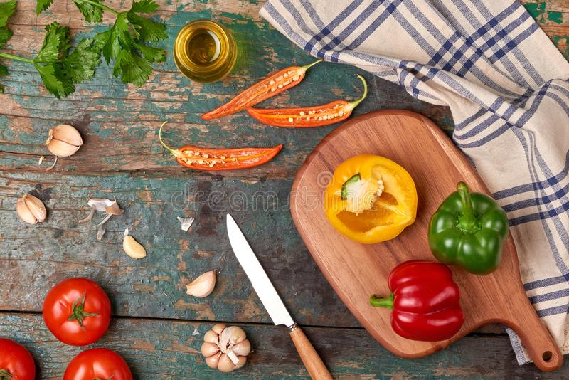 Include fresh organic vegetables and wood cutting board on wooden floor with copy space still life royalty free stock photography