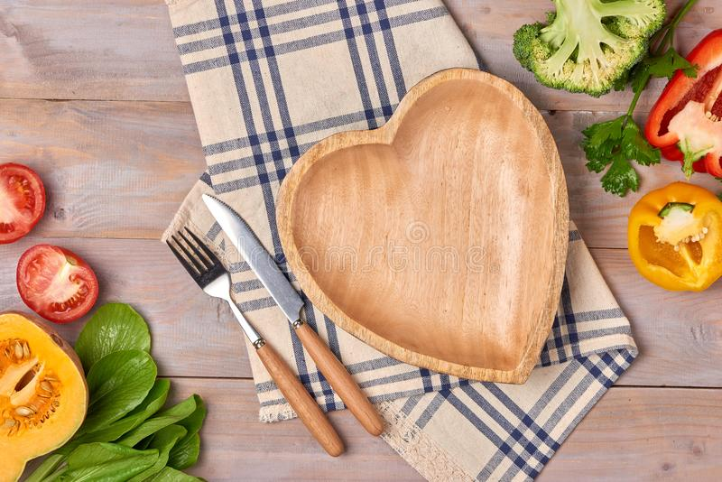 Include fresh organic vegetables and wood heart disk on wooden f stock photos