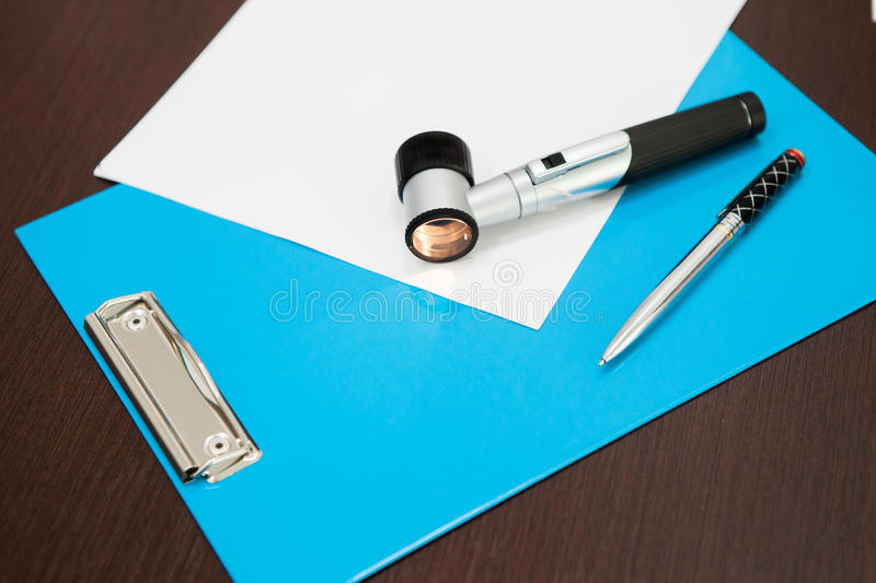 Included Dermatoscope on the table stock images