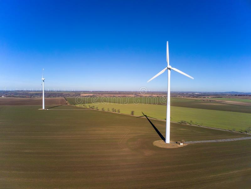 Aerial view of two wind turbines on a field royalty free stock image