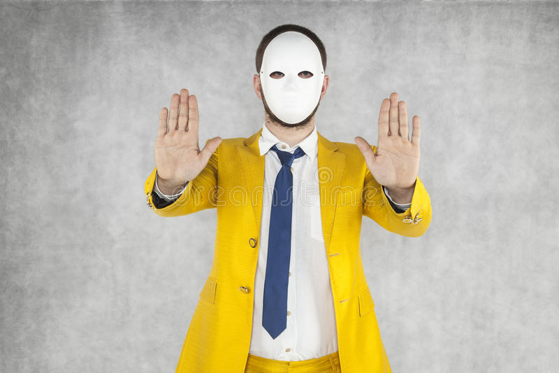 Incognito person performs stop gesture royalty free stock image