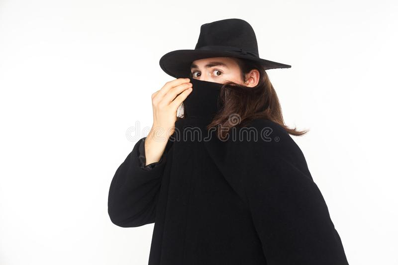 Incognito secrecy agent spy, looking at camera with big eyes stock photo