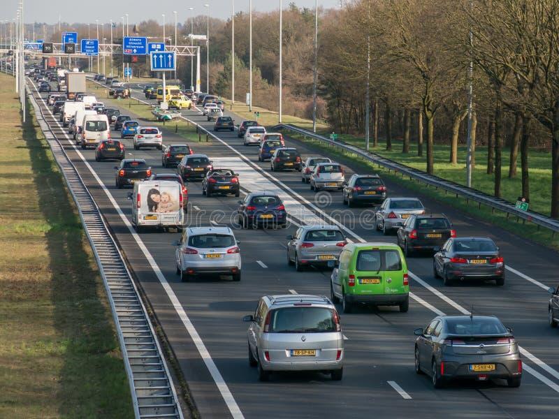 Incolonnamento durante l'ora di punta sull'autostrada senza pedaggio, Paesi Bassi fotografie stock