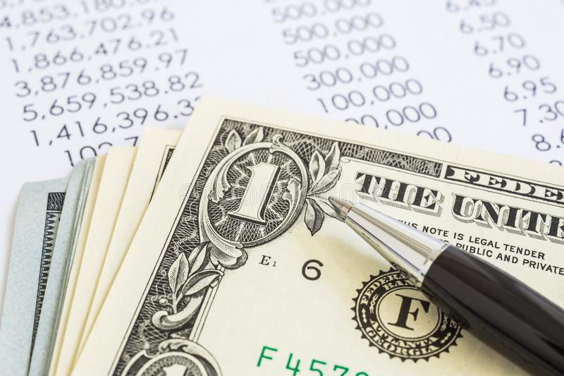 Income annual reports and US money dollar. stock photos