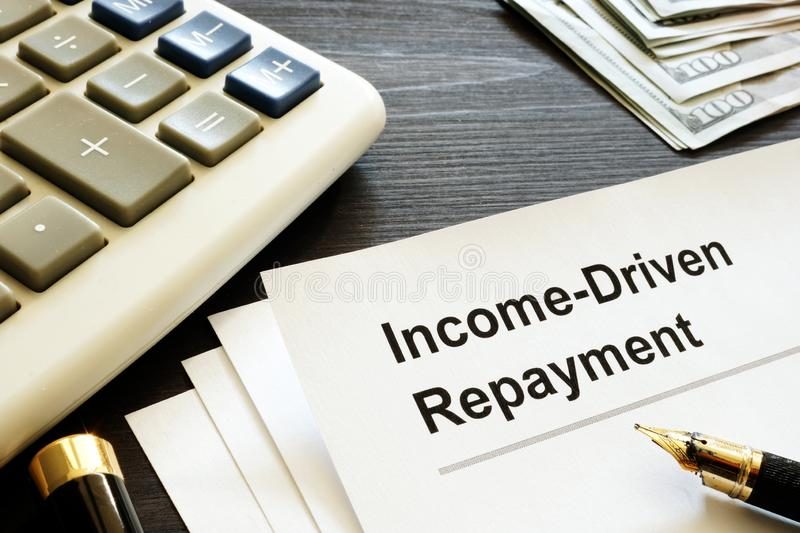Income Driven Repayment. Papers, calculator and money. Income Driven Repayment concept. Papers, calculator and money royalty free stock photography