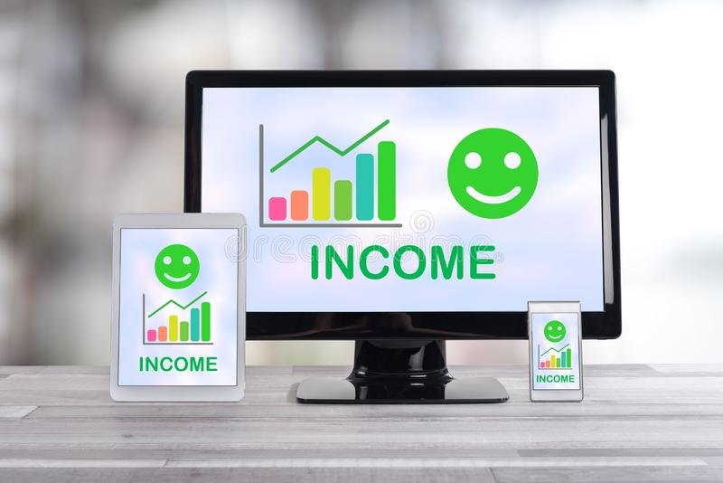 Income growth concept on different devices. Income growth concept shown on different information technology devices stock photo