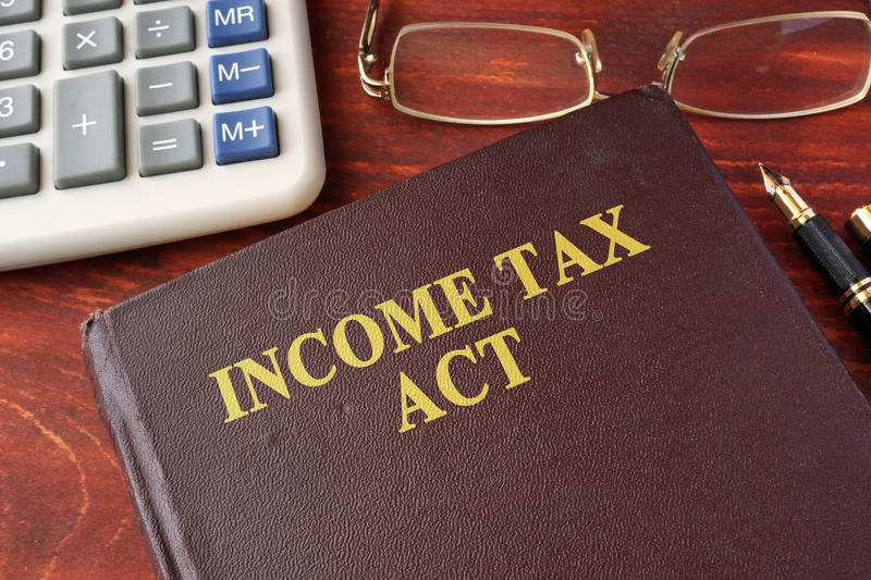 The Income Tax Act. Book with title The Income Tax Act stock images