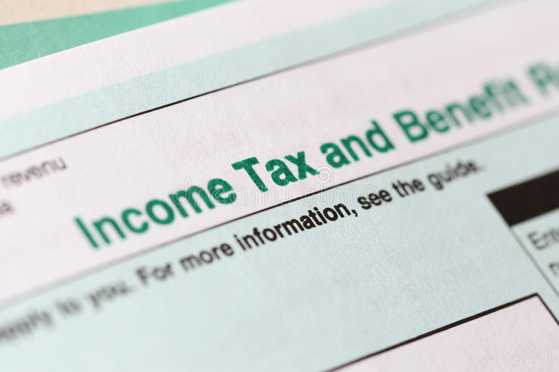 Income tax form. Macro Income tax and benefit form royalty free stock photography