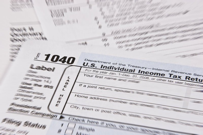 Income Tax Return. U.S. Income Tax Return with focus around 1040 Individual Income Tax Return stock photos