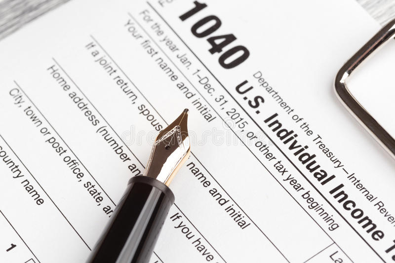 Income Tax Return Form. With fountain pen stock image