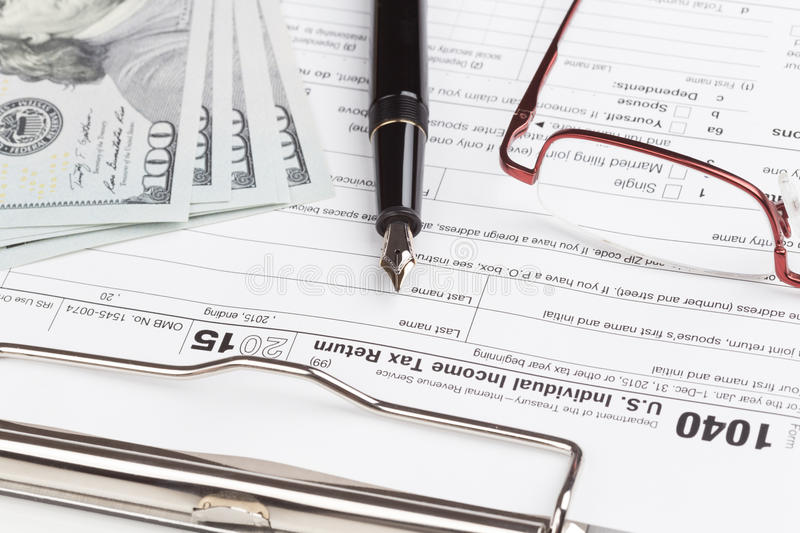 Income Tax Return Form. With fountain pen and dollars stock photography