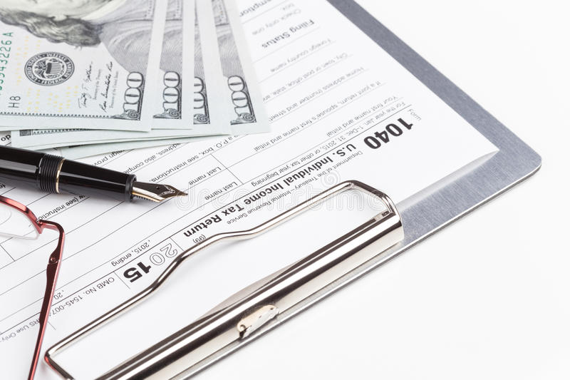 Income Tax Return Form. With fountain pen and dollars stock images