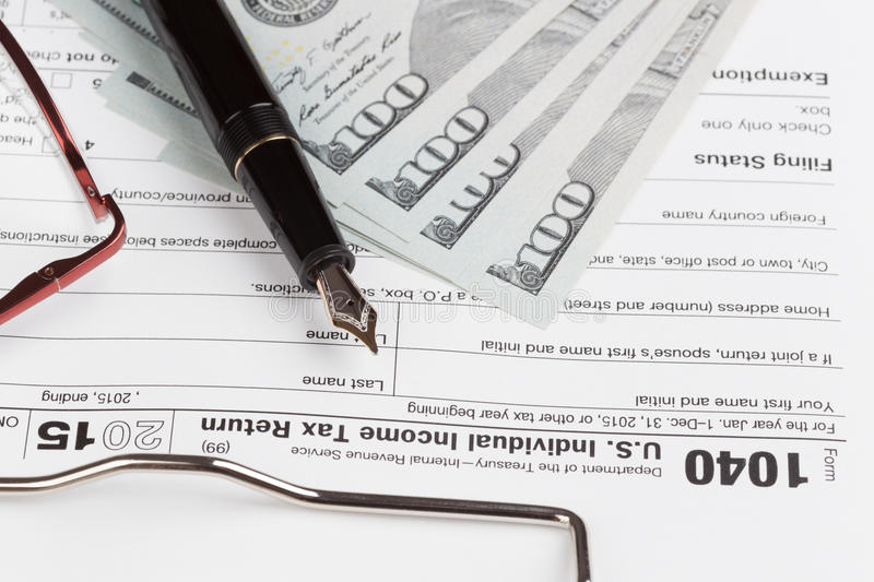 Income Tax Return Form. With fountain pen and dollars royalty free stock image