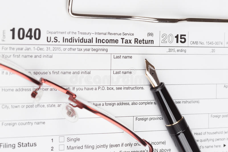 Income Tax Return Form. With fountain pen and glasses stock photography