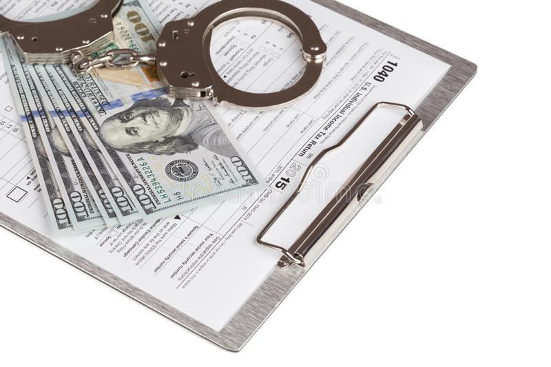 Income Tax Return Form. With handcuffs and dollars royalty free stock photo