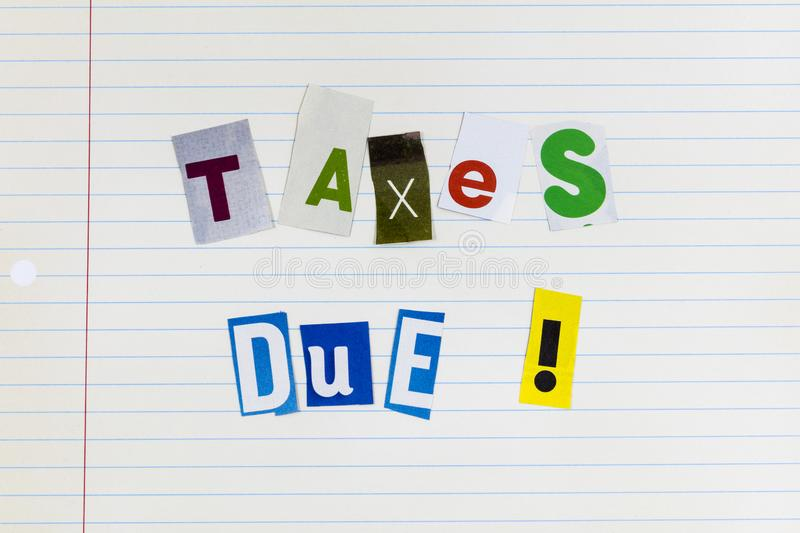 Income tax time due pay up threat liability. Income tax time reminder due pay up threat liability letterpress note paper lined magazine newspaper clipping cutout stock photos