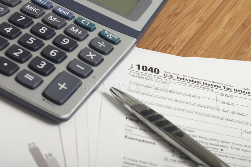 Income Taxes. Close up U.S. taxes papers royalty free stock photography