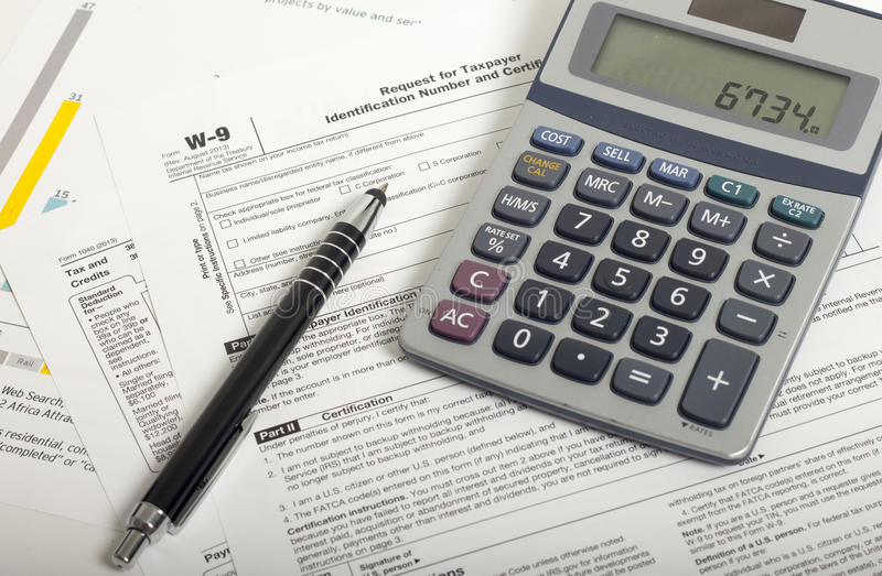 Income Taxes. Close up U.S. taxes papers stock image