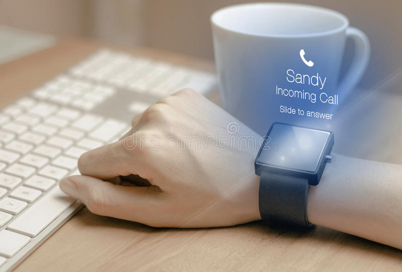 Incoming call icon with smartwatch. A smartwatch is a wearable computing device that closely resembles a wristwatch or other time-keeping device stock photos