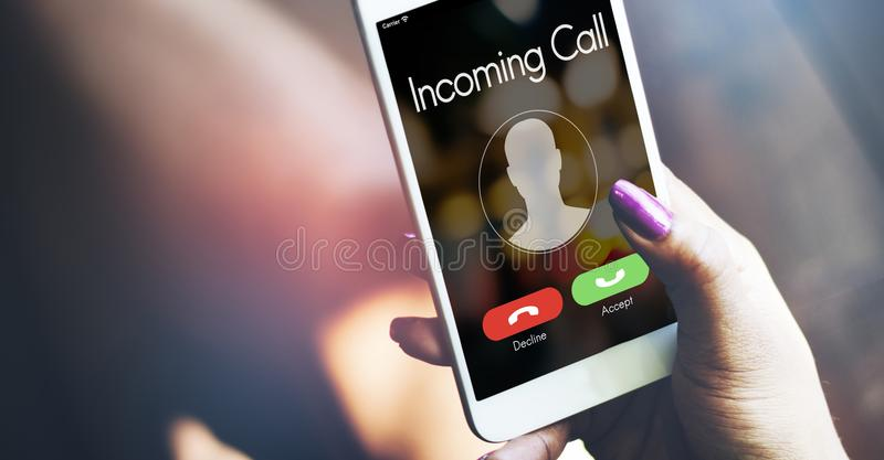 Incoming call smartphone in hand stock image