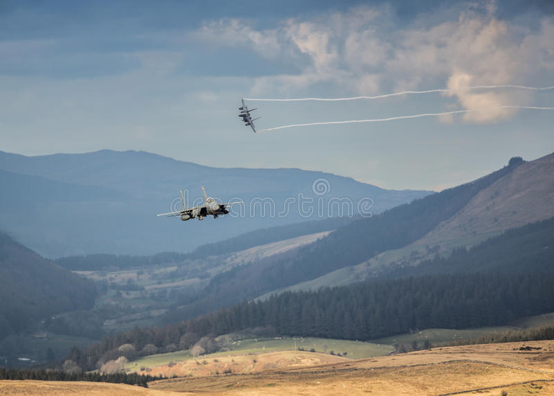 Incoming Fighter jets. Incoming low level F15 fighter jets over land on a training mission, USAF, United States Air force royalty free stock images