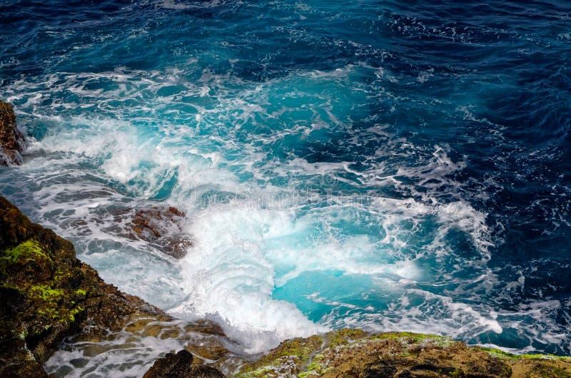 Incoming waves hitting the rocks of coastline. Island Sal, Cape Verde royalty free stock photos