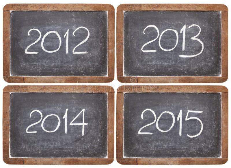 Incoming years on blackboard stock image