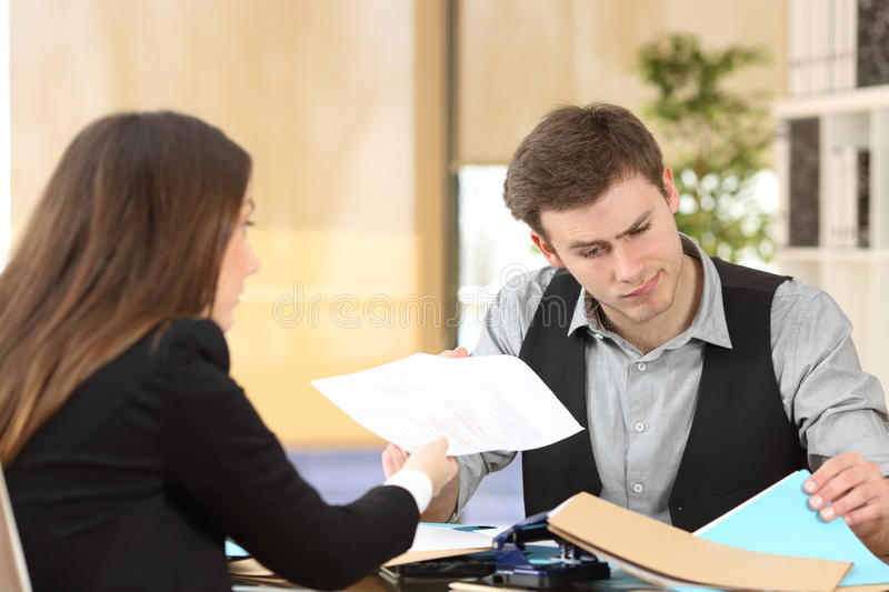 Incompetent businessman attending a client royalty free stock photography
