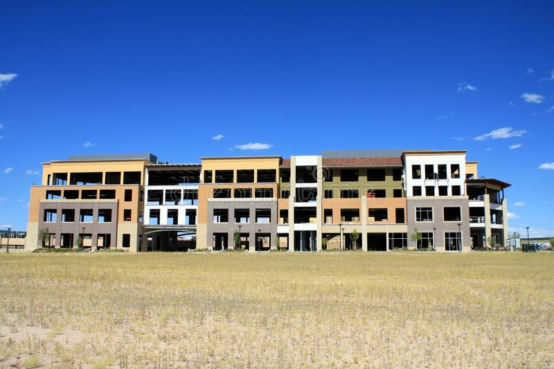 Incomplete abandoned apartment building. This is a full view of a unfinished abandoned public commercial building or apartments, signs of a bad economy stock photography