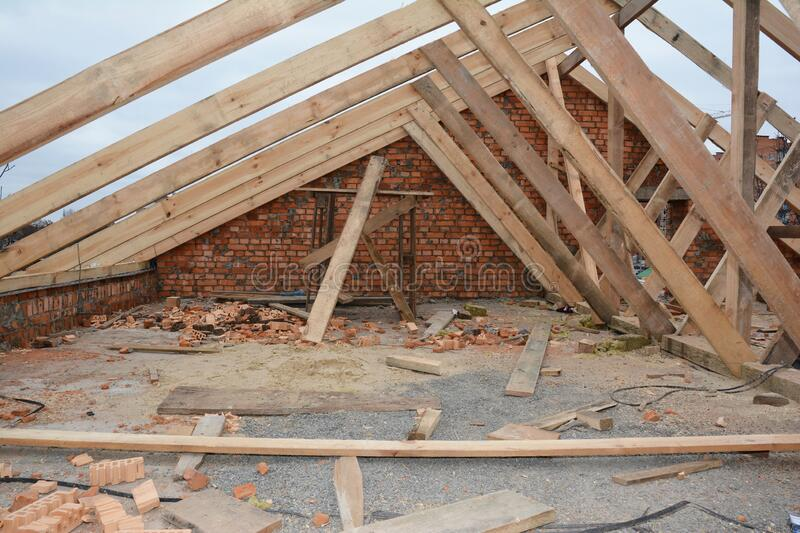 Incomplete attic house roof wooden frame construction.  Unfinished attic house rooftop roofing construction with trusses, wooden royalty free stock photos
