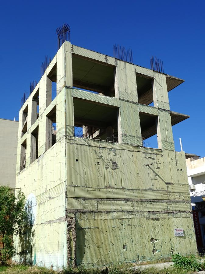 Incomplete Concrete Frame Building. A multi level partially built concrete slab and pillar house with synthetic insulation cladding stock photography