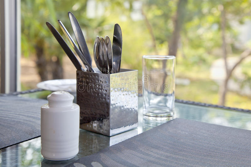 Incomplete Dining table setting at a picture wi royalty free stock images