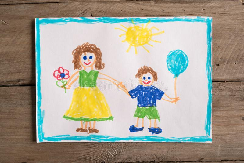 Incomplete family drawing. Children`s drawing of family single mom and son. Incomplete family concept royalty free stock photos